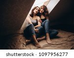 the beautiful sisters  sitting... | Shutterstock . vector #1097956277