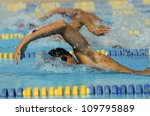 Male participants competing in a swimming race - stock photo