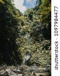 nungnung waterfall in the bali... | Shutterstock . vector #1097984477