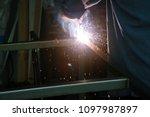 welding. a welder arc welds... | Shutterstock . vector #1097987897