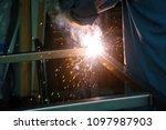 welding. a welder arc welds... | Shutterstock . vector #1097987903