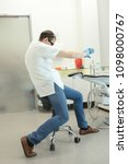 dentist stretching arms in his...   Shutterstock . vector #1098000767