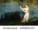 asian woman practicing tai chi...   Shutterstock . vector #1098001457