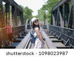 young woman traveling... | Shutterstock . vector #1098023987