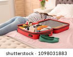 exhausted woman lying near... | Shutterstock . vector #1098031883