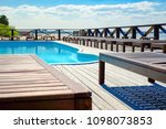 sun loungers by the pool  warm... | Shutterstock . vector #1098073853
