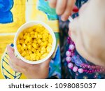 cup corn baby food in the park | Shutterstock . vector #1098085037