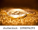bitcoin on a gold background | Shutterstock . vector #1098096293