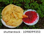 fried pancakes and red jam on... | Shutterstock . vector #1098099353