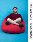 young smiley man sitting on a... | Shutterstock . vector #1098125753
