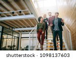 group of coworkers going down... | Shutterstock . vector #1098137603