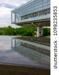 Small photo of Little Rock, AR—May 22, 2018; view of the Clinton Presidential Library reflecting off of a fountain. The Clinton Library is a center piece of Arkansas architecture and landmarks in the capital.