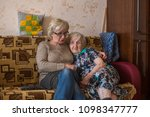 an elderly woman with her adult ... | Shutterstock . vector #1098347777