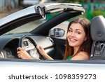 young woman driving a car in... | Shutterstock . vector #1098359273
