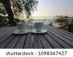 hot coffee on wooden table with ... | Shutterstock . vector #1098367427