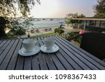 hot coffee on wooden table with ... | Shutterstock . vector #1098367433