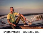 young handsome tattooed man...   Shutterstock . vector #1098382103