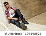 Teen boy dressed in Hipster style. - stock photo