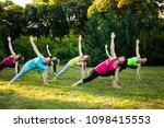 group of women attending a yoga ...   Shutterstock . vector #1098415553