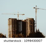 unfinished skyscrapers during... | Shutterstock . vector #1098430007