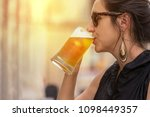 woman having a mug of cold beer ...   Shutterstock . vector #1098449357