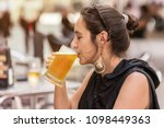 woman having a mug of cold beer ...   Shutterstock . vector #1098449363
