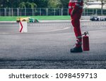 Small photo of Race marshall stand guard of the safety crew ready to rescue in case of accident during a racing car.