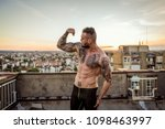 young handsome tattooed man...   Shutterstock . vector #1098463997