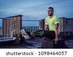 young handsome tattooed man...   Shutterstock . vector #1098464057