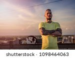 young handsome tattooed man...   Shutterstock . vector #1098464063