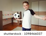 a cute boy in football suit and ... | Shutterstock . vector #1098466037