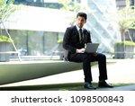 handsome business man sitting...   Shutterstock . vector #1098500843