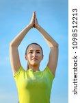 young girl doing yoga outdoor   Shutterstock . vector #1098512213