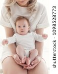 young mother holding her... | Shutterstock . vector #1098528773