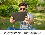 young man listening music with...   Shutterstock . vector #1098530387