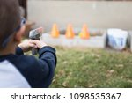 small boy does target practice... | Shutterstock . vector #1098535367