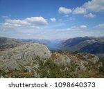 the norwegian fjord lyusebotn ... | Shutterstock . vector #1098640373