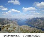 the norwegian fjord lyusebotn ... | Shutterstock . vector #1098640523