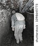 Small photo of Exploring three hundred year old Bolivian mines. Into the darkness!