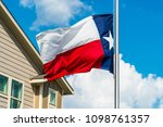 Texas State Flag Flying Lowere...