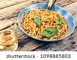 pasta and red wine. basil ... | Shutterstock . vector #1098885803