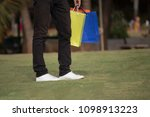 low section of man carrying... | Shutterstock . vector #1098913223