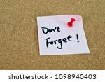 Small photo of Dont forget notice written on sticker