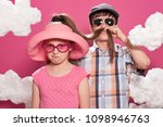 fashionable girl and boy posing ... | Shutterstock . vector #1098946763