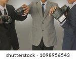 businessmen put the boxing... | Shutterstock . vector #1098956543