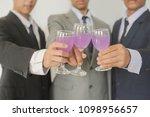 business group cheers  wine... | Shutterstock . vector #1098956657