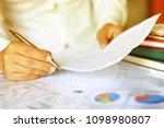 asian women read the business... | Shutterstock . vector #1098980807