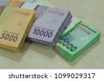 "Small photo of Indonesian money for eid holiday allowance called ""THR"""