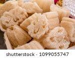 natural sponges in local market.... | Shutterstock . vector #1099055747