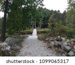 pathway to a bridge. | Shutterstock . vector #1099065317